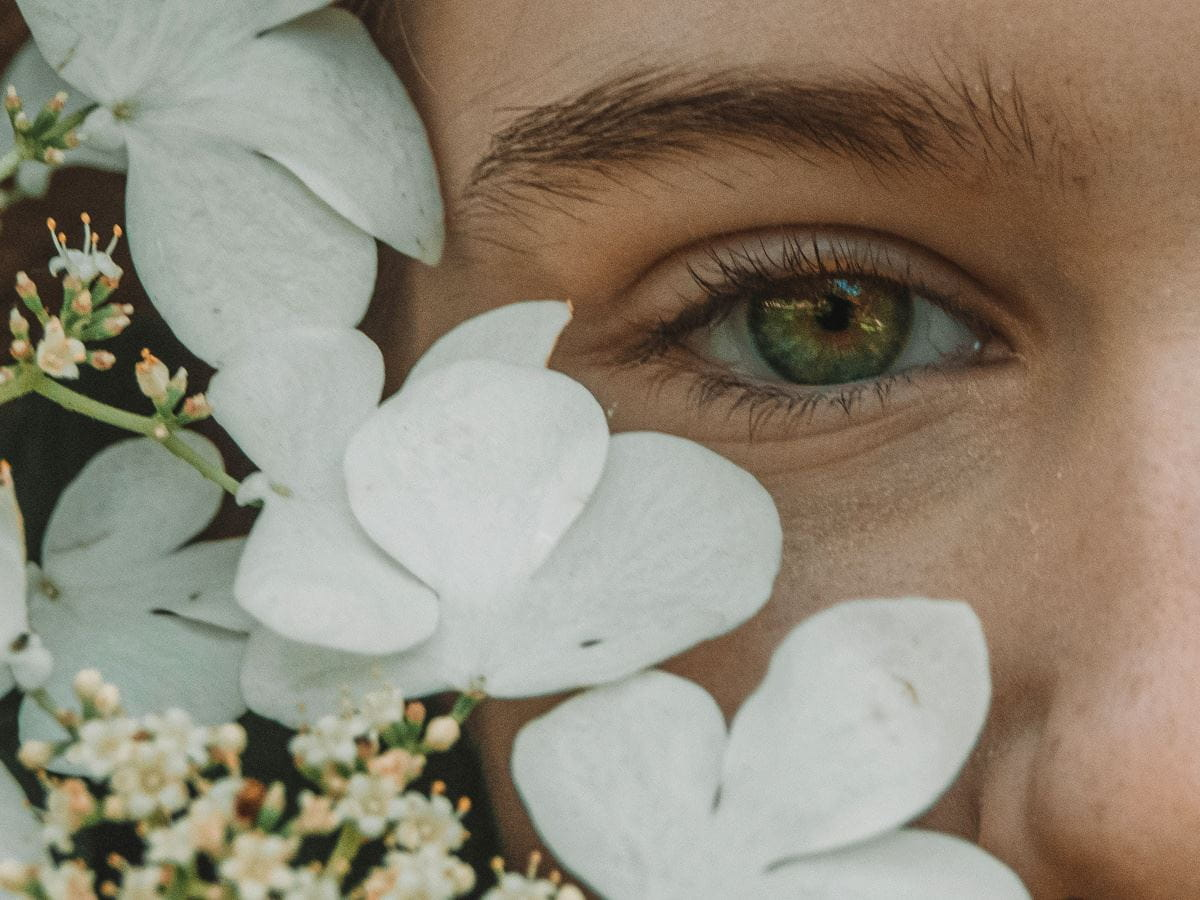 lady with flowers on her face