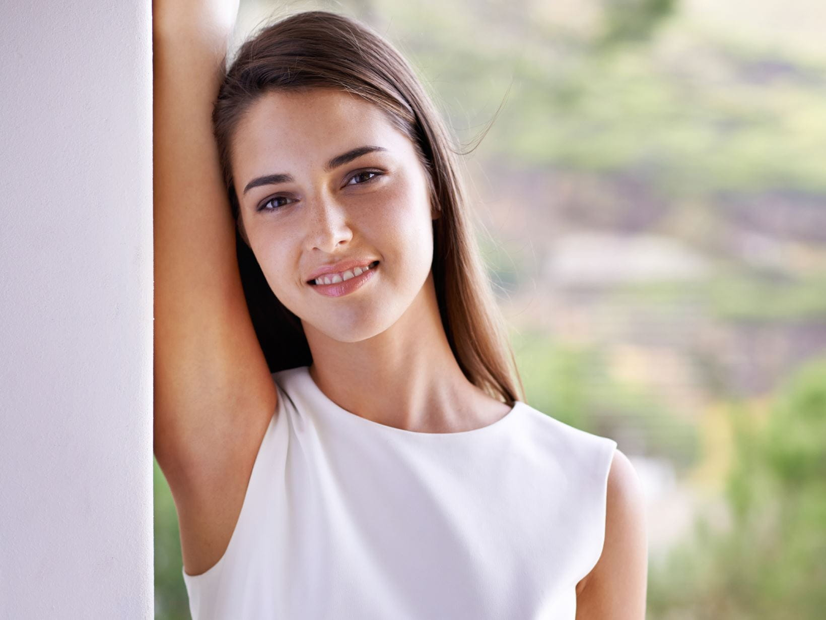 woman smiling showing her armpit