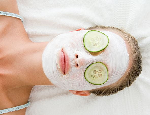 lady lying down with a face mask applied