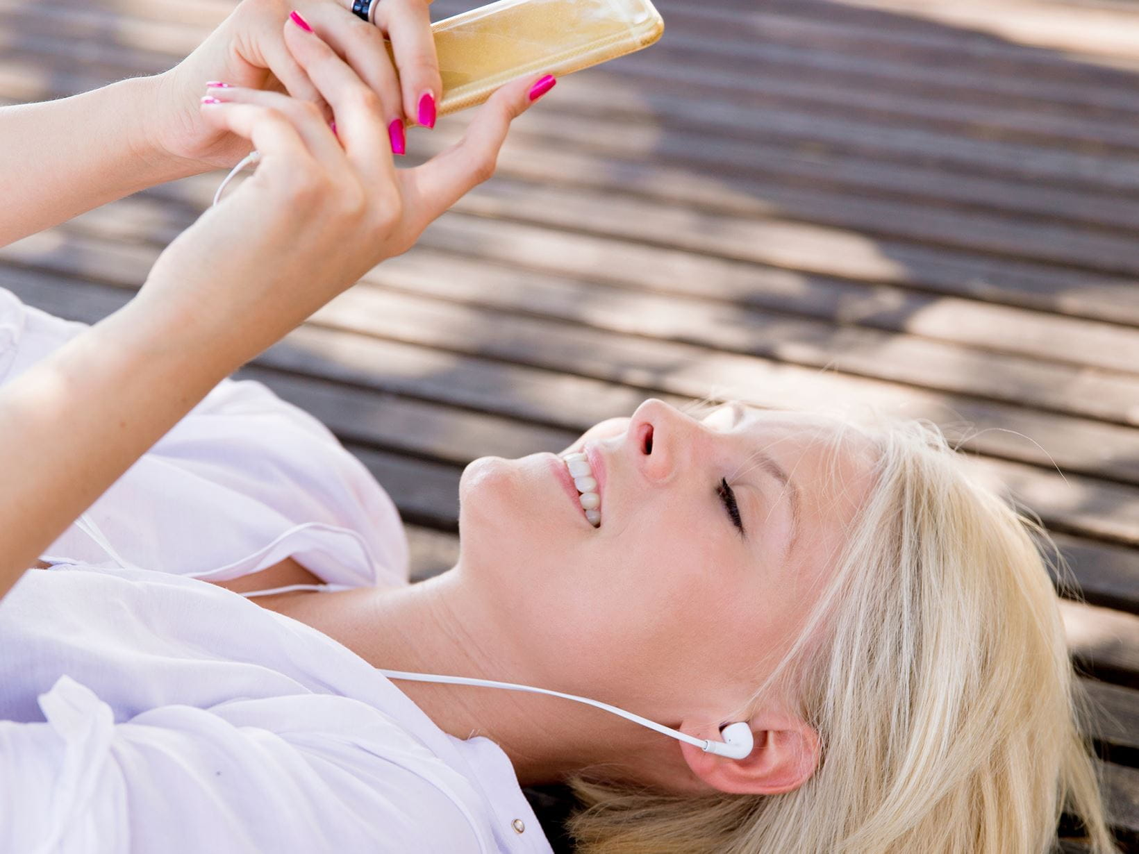 lady listening to music from her phone