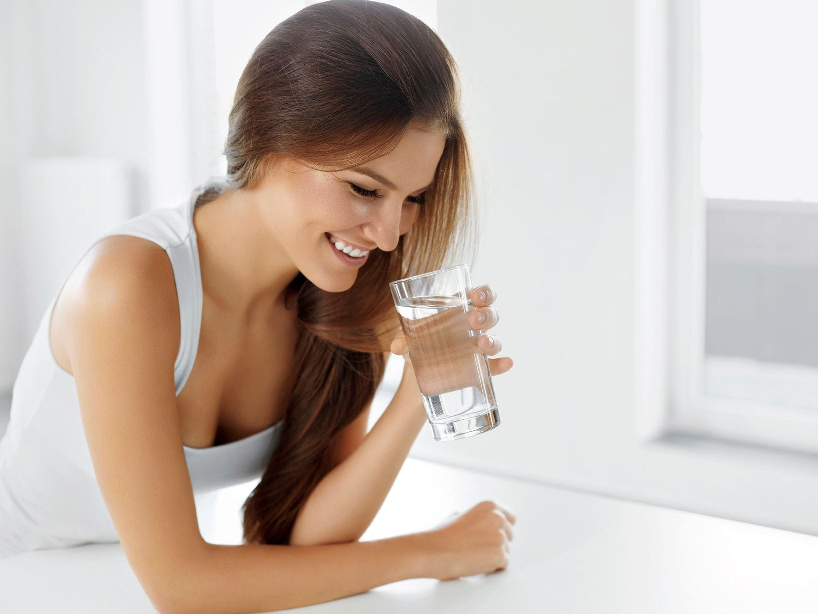 woman-holding-a-glass-of-water