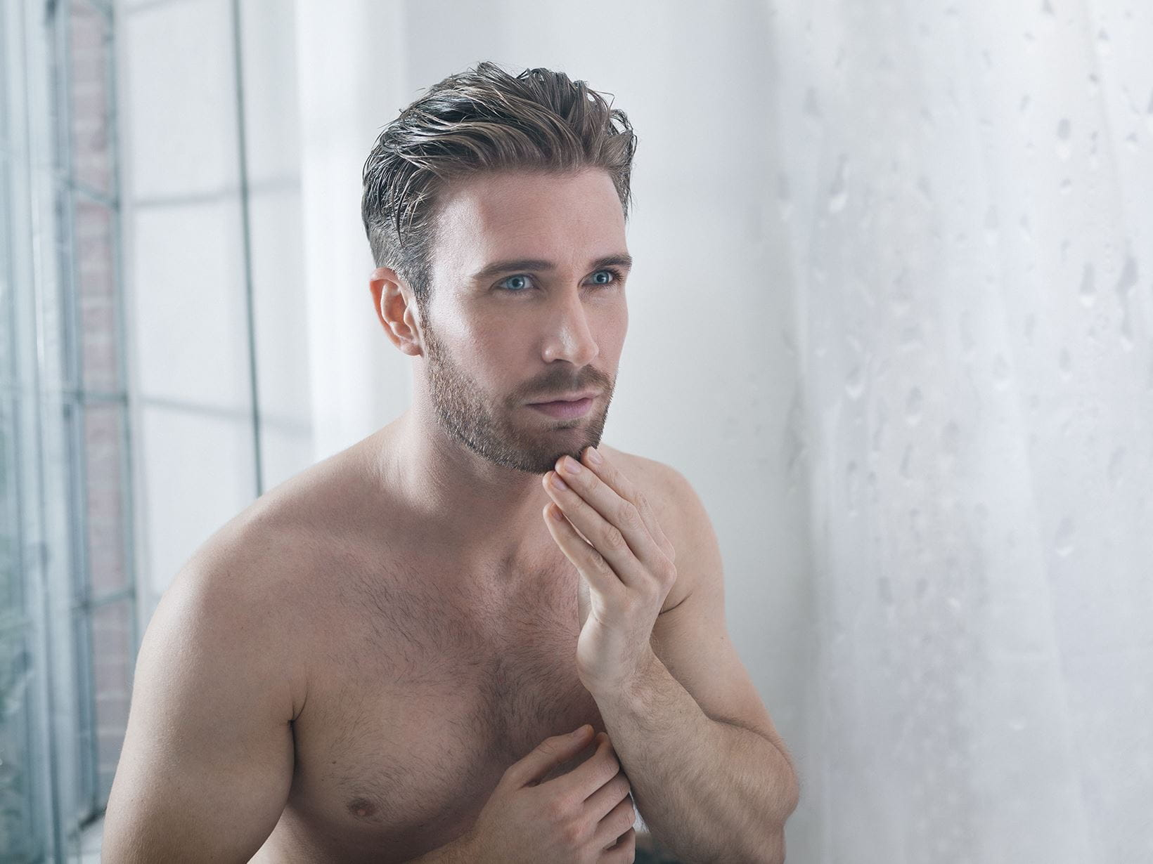 man cleansing blocked nose pores in the shower