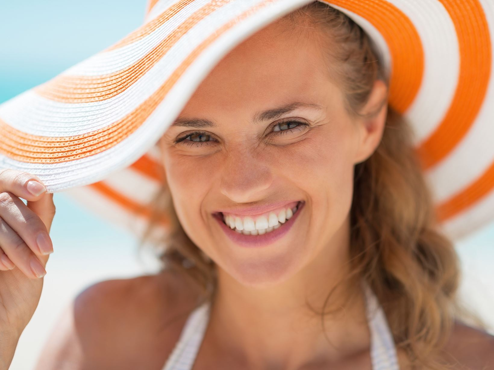 lady in orange hat smiling