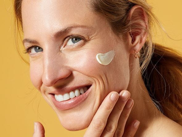 smiling lady with sunscreen on her face