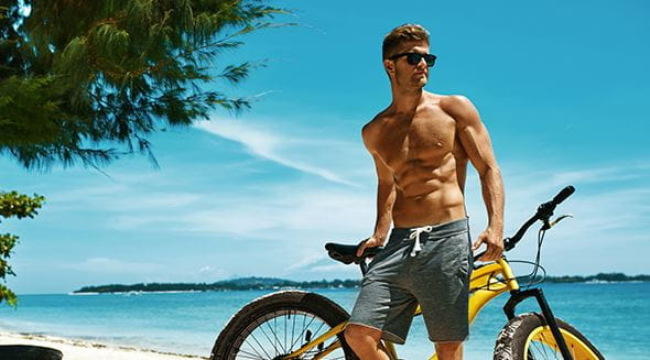 Nivea men bicycle on the beach